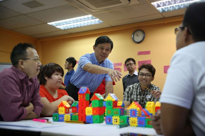 People's Association deputy chairman Chan Chun Sing (middle) touring the classes at Nacli and speaking to participants.
