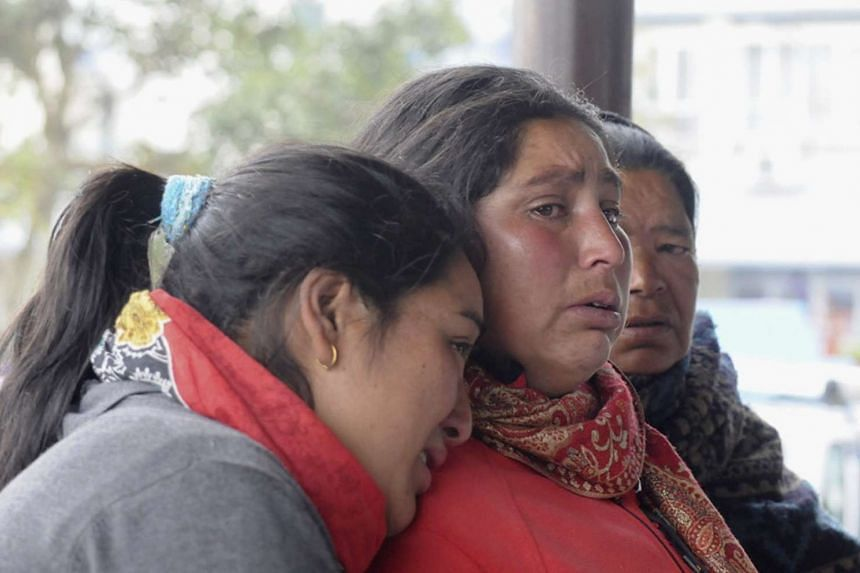Relatives of a plane crash victim mourn as they are waiting for information about the accident at Pokhara Airport, in Pokhara, Nepal on Feb 24, 2016.