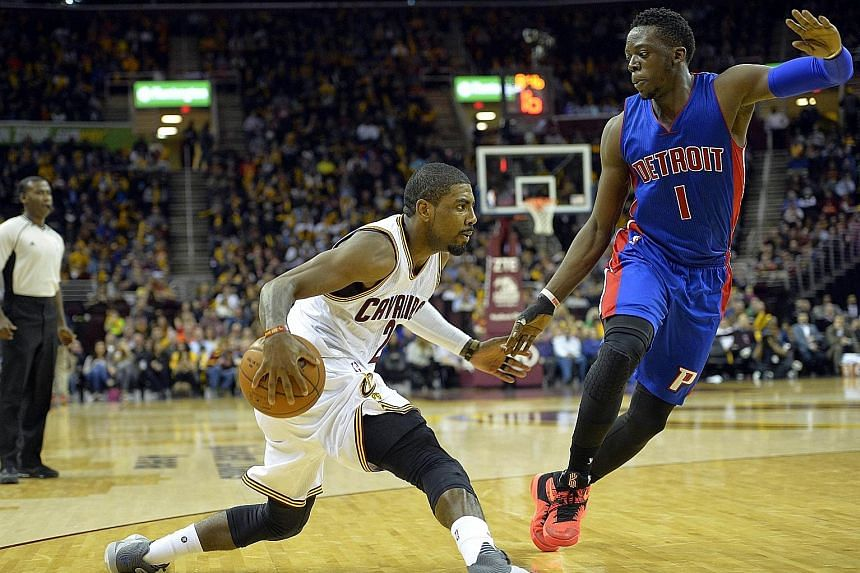 Cavaliers guard Kyrie Irving (left) dribbling against Pistons guard Reggie Jackson during the game on Monday night.