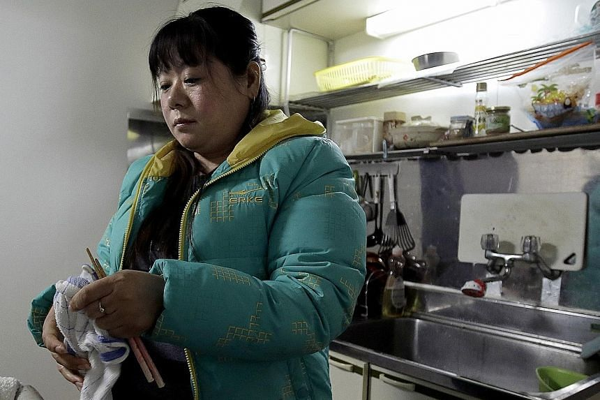 Chinese national Tang Xili ended up in a shelter in Japan after leaving an employer she says owes her 3.5 million yen (S$43,800) in unpaid wages.