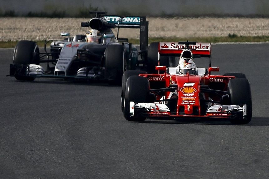 Sebastian Vettel (front) will be hoping that his Ferrari race car will stay ahead of Lewis Hamilton's Mercedes when the new F1 season begins next month.