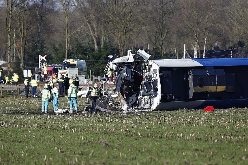 A train driver died and seven people were injured yesterday in a rail accident in the Dutch town of Dalfsen. The passenger train collided with a mobile hydraulic platform, causing several coaches to overturn, a spokesman for the emergency services to