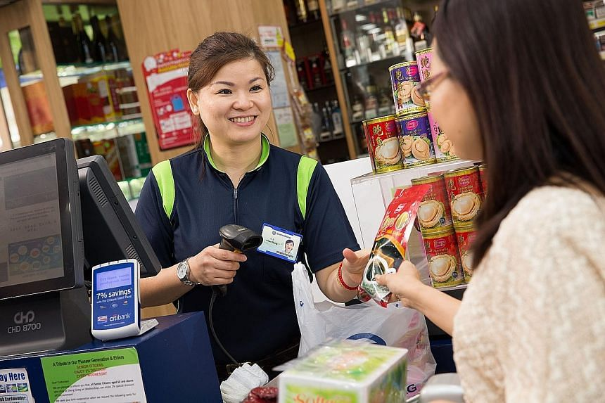 A customer shopping at a Sheng Siong supermarket. With the opening of five new stores last year, the total number of stores for the chain now stands at 39, with a total retail area of 431,000 sq ft.