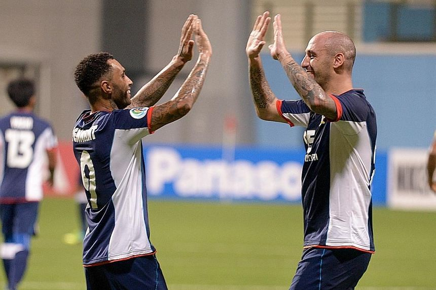 Jermaine Pennant (far left) and Billy Mehmet celebrating their opponents' own goal, which gave Tampines a commanding 4-0 lead. The Stags are aiming to make the knockout phase of the AFC Cup for the first time since 2011.