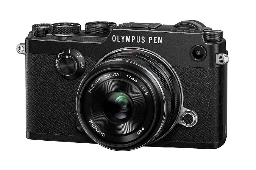 The PEN-F is easily the most beautiful PEN. Available in silver or black, it retains the series' retro rangefinder-like design. But the PEN-F looks much cleaner than its predecessors, with not a single screw visible.