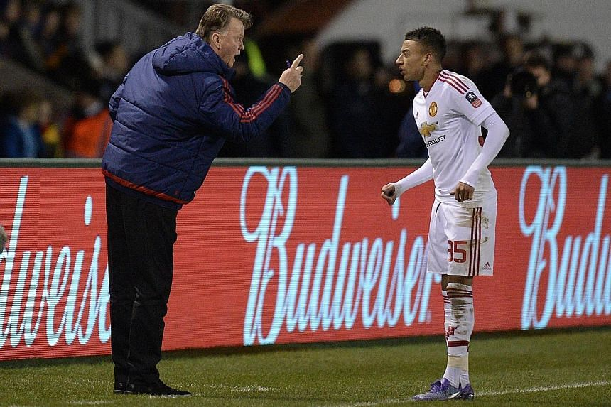 Manchester United manager Louis van Gaal gestures towards Jesse Lingard during their FA Cup fifth-round tie with Shrewsbury. The midfielder scored the third goal to help United to a 3-0 win and progress to the quarter-finals where they will face fell