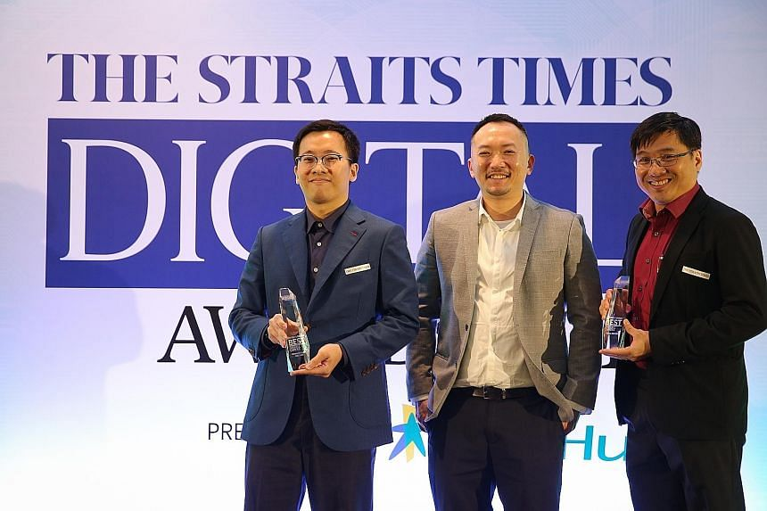 Straits Times deputy editor Ignatius Low (centre) with Panasonic Singapore marketing executive Chung Ziang (left), who accepted the award for Editor's Choice for Best Overall Camera for the Panasonic Lumix DMC-GX8, and Canon Singapore head of marketi