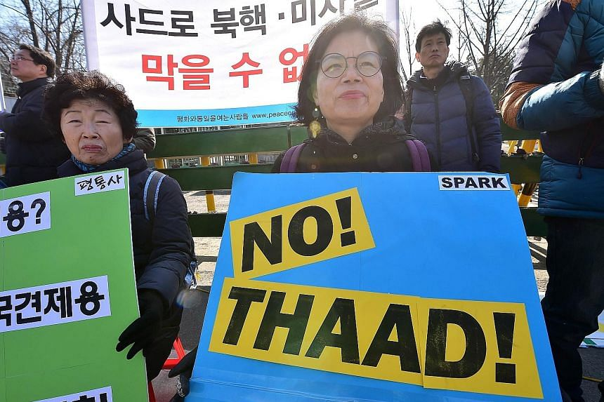 South Korean anti-war activists rallying in Seoul yesterday against talks between their country and the US on deploying the Terminal High Altitude Area Defence System.
