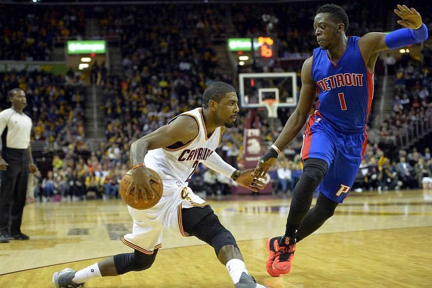 Cleveland Cavaliers guard Kyrie Irving (2) dribbles against Detroit Pistons guard Reggie Jackson (1) in the third quarter at the Quicken Loans Arena.