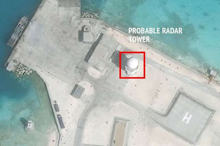 A satellite image shows construction of possible radar tower facilities in the Spratly Islands in the disputed South China Sea by China.