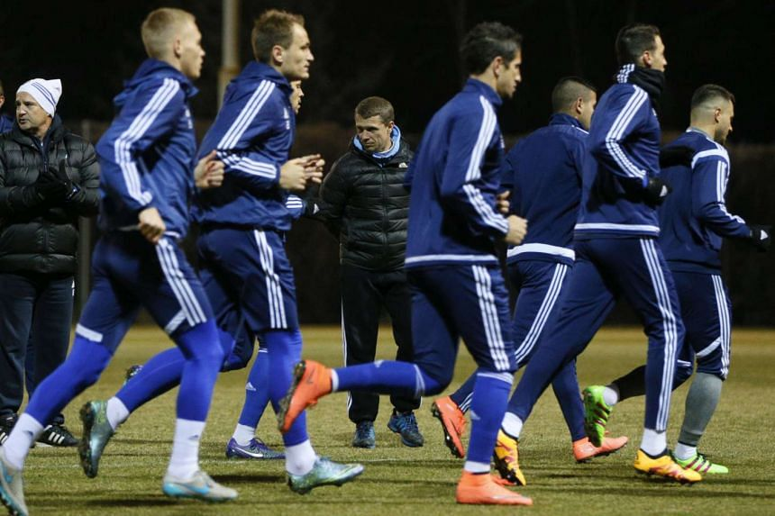 Dynamo Kiev's coach Serhiy Rebrov (centre) and players during training prior to Uefa Champions League match against Manchester City.