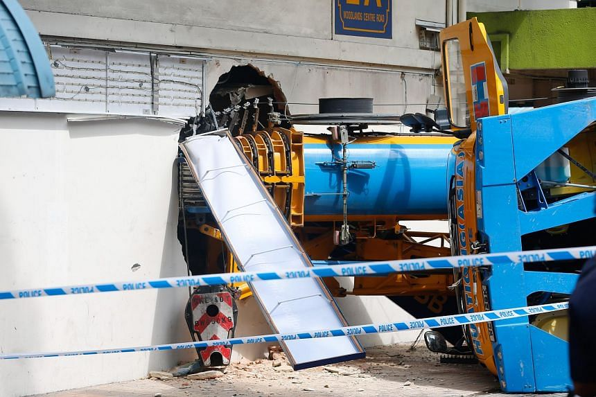 A mobile crane crashed into a POSB branch in Woodlands on Wednesday (Feb 24).