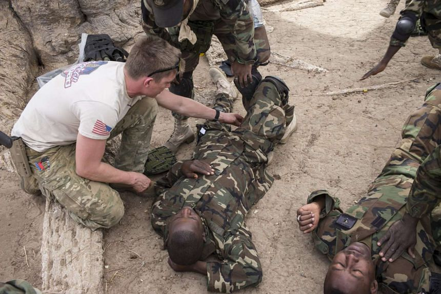 A US special forces soldier trains Nigerian soldiers in first aid during Flintlock 2016.