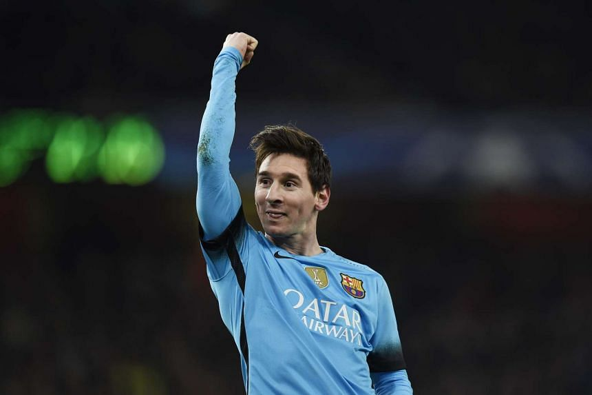 Lionel Messi celebrates scoring the second goal for Barcelona.