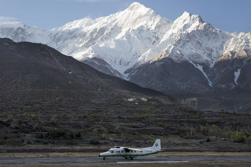 A twin aircraft from Tara Airlines landing at Jomsom Airport in Jomsom, a popular resort town west of Nepal's Kathmandu.