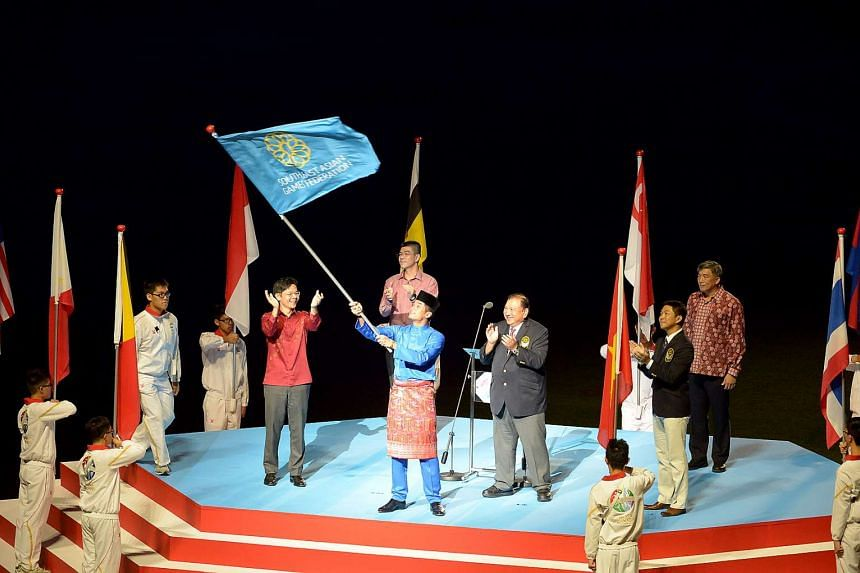 Mr Khairy Jamaluddin Abu Bakar (in baju kurung), Malaysia's Minister of Youth & Sports, waving the SEA Games federation flag, during the handover for the 2017 SEA Games.