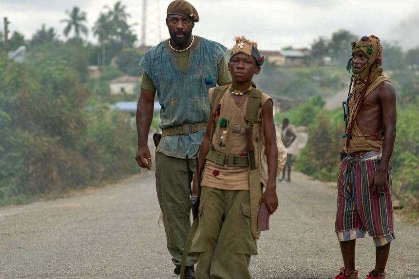 Abraham Attah (above, centre) plays child soldier Agu and veteran actor Idris Elba (above, left) plays a brutal militia chief in Beasts Of No Nation.