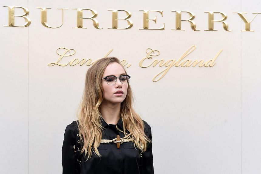 British model and actress Suki Waterhouse arrives for the Burberry show at Kensington Gardens during the London Fashion Week.