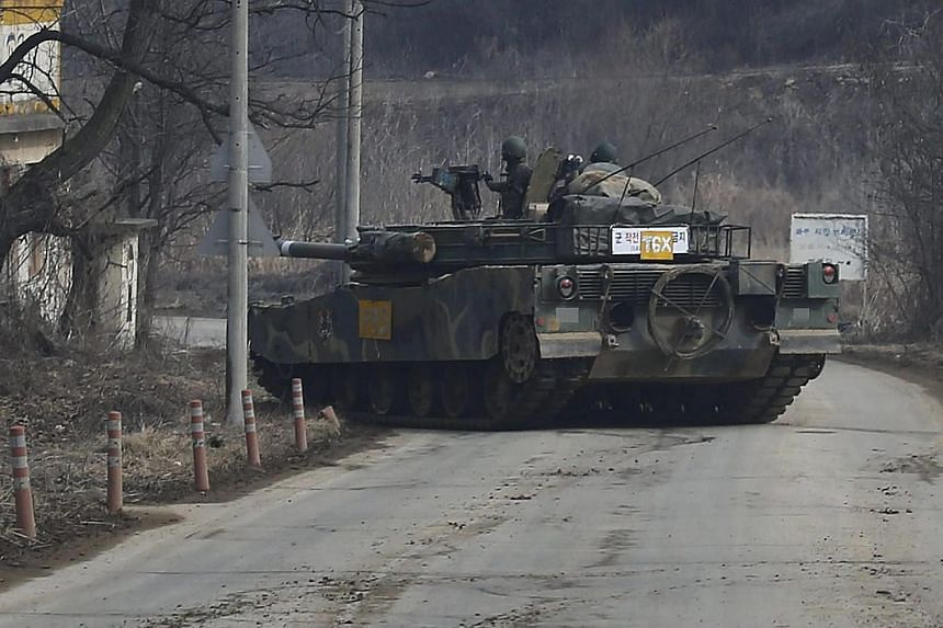 A South Korean K-1 tank moves near the western section of the inter-Korean border in Paju.