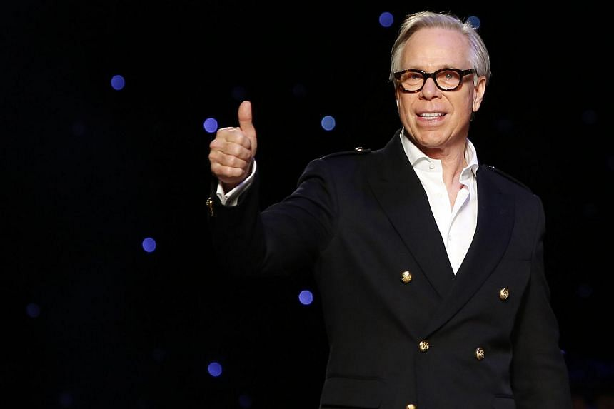 Designer Tommy Hilfiger acknowledges attendees after presenting his Fall/Winter 2016 collection during New York Fashion Week on Feb 15, 2016.