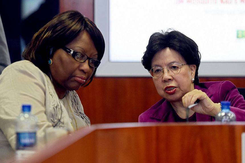 Margaret Chan (right) and Pan American Health Organization (PAHO) Director Carissa Etienne talk during a meeting at the National Centre for Risk and Disaster Management in Brasili.