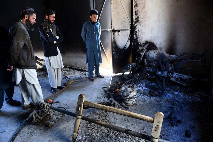 Pakistani tribesmen gather at the site of a Taleban militant attack in Mohmand district on Feb 18, 2016.