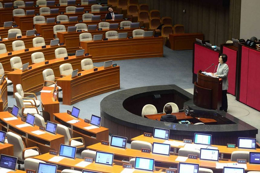 This picture taken on Feb 24, 2016 shows Ms You Seung Hee (right), a lawmaker of South Korea's main opposition Minju Party, delivering a speech to call for revision of disputed anti-terrorism bill at the main floor of the parliament in Seoul. South