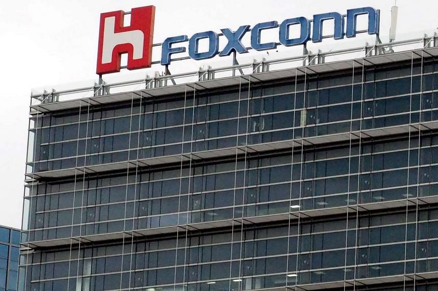 Foxconn is delaying the takeover of Sharp as the latter had included new terms in the deal that needed to be clarified.