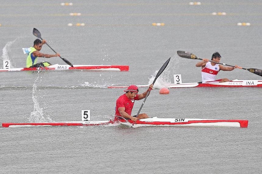 Singapore's Mervyn Toh (in red) competing in the canoeing finals at the SEA Games in the Republic last year.
