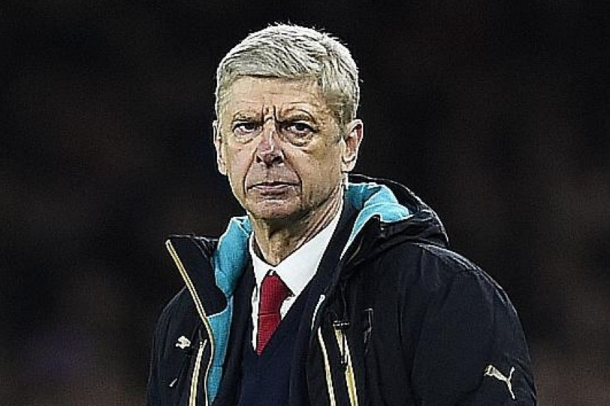 Arsenal manager Arsene Wenger (above) is displeased by his team's vulnerability to counter-attacks in the game (left) against Barcelona. The Gunners now have a 2-0 deficit going into the second leg at the Nou Camp next month.