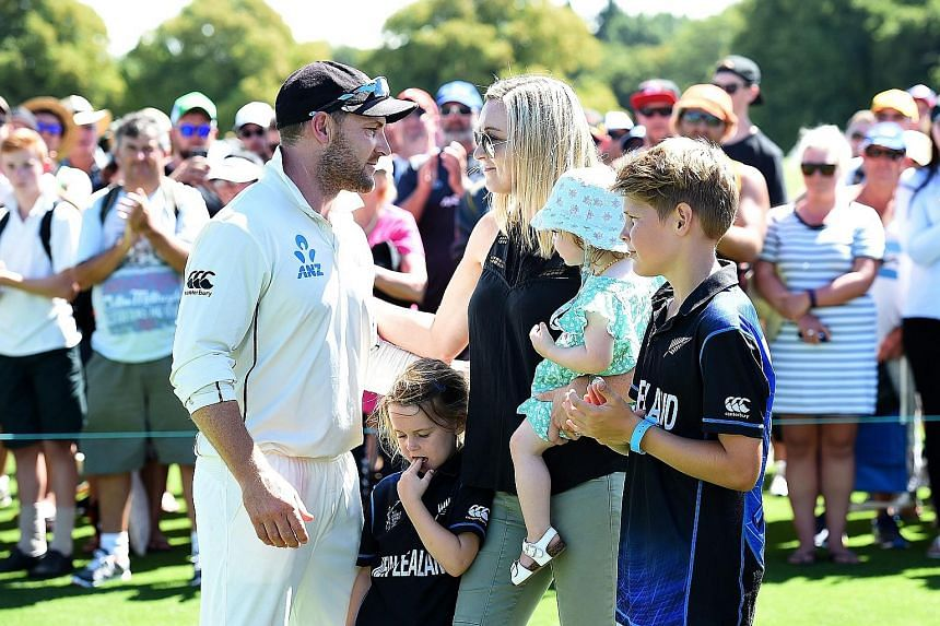 Retiring New Zealand cricket captain Brendon McCullum greeting his wife and children after making a farewell speech at Hagley Oval in Christchurch yesterday. New Zealand lost the Test and the series, despite McCullum scoring the fastest century in Te