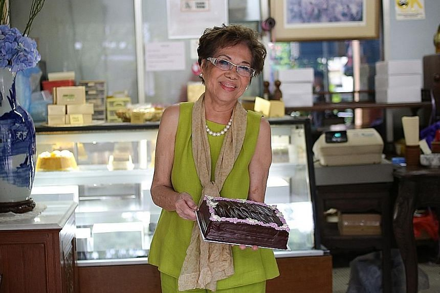 Mrs Violet Kwan with her rich and moist chocolate cake.