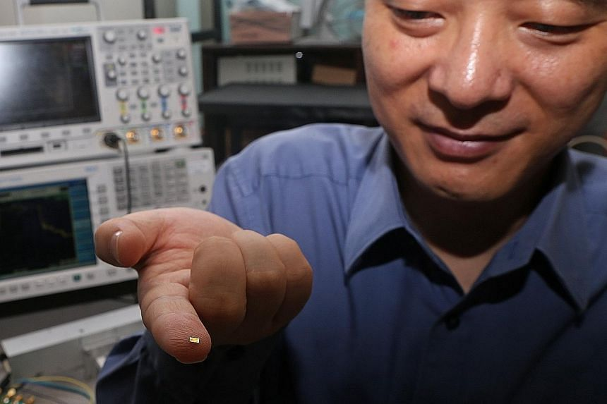 Prof Zheng from NTU's School of Electrical and Electronic Engineering with the new radar camera microchip on his fingertip. Despite its size, it can produce images twice as clear as conventional radar cameras.