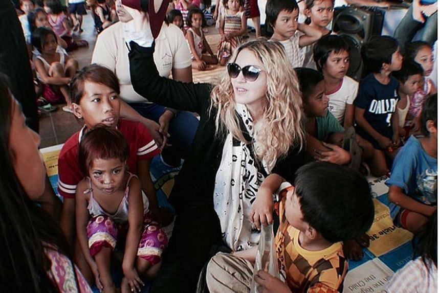 Madonna visiting Bahay Tuluyan, home to about 500 abused or abandoned children.