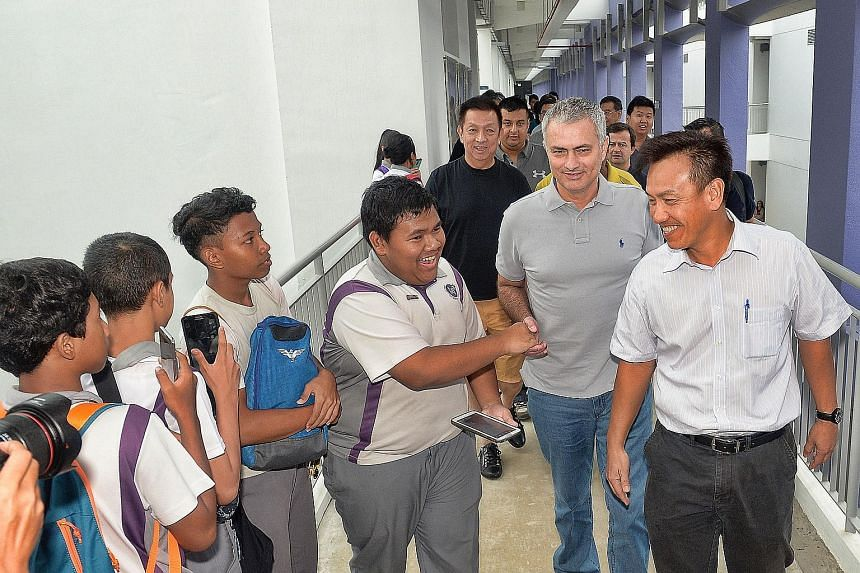 It was all smiles and handshakes yesterday as Martin Tan (extreme right), principal of Northlight School, ushered Jose Mourinho around, to the delight of students and staff.
