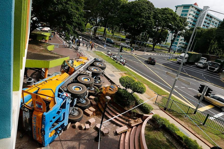 A mobile crane piled into a Woodlands Housing Board block yesterday morning after its driver lost control at a junction. Nobody was injured in the 7am accident, which left a 2m-wide hole in the brick wall of a POSB branch at the ground floor of Block