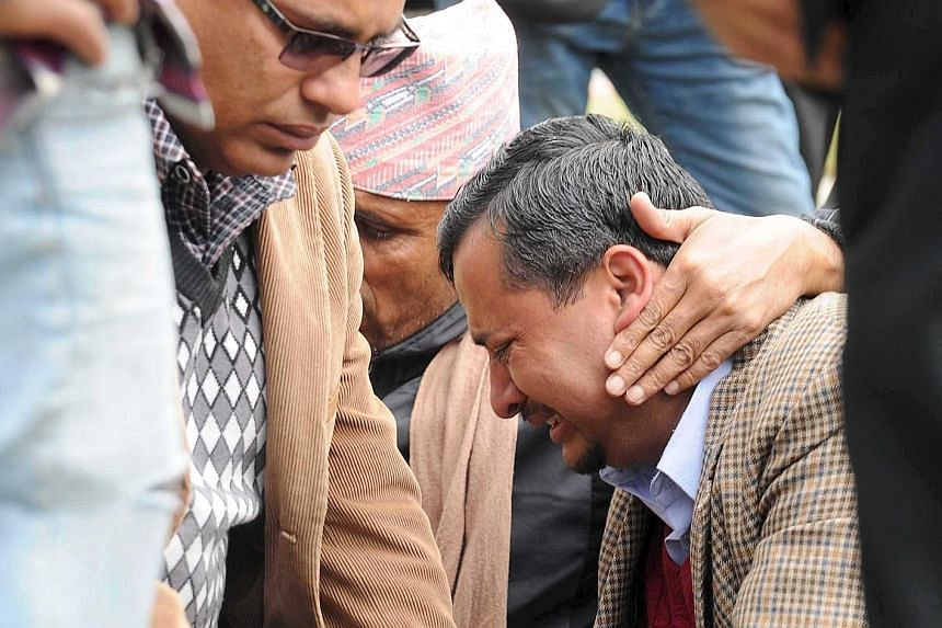 A family member in tears as he waited at the airport after a Tara Air plane crashed in bad weather in Pokhara, Nepal, yesterday. The cause of the crash was not known. A statement on Tara Air's website said weather conditions were good when the plane