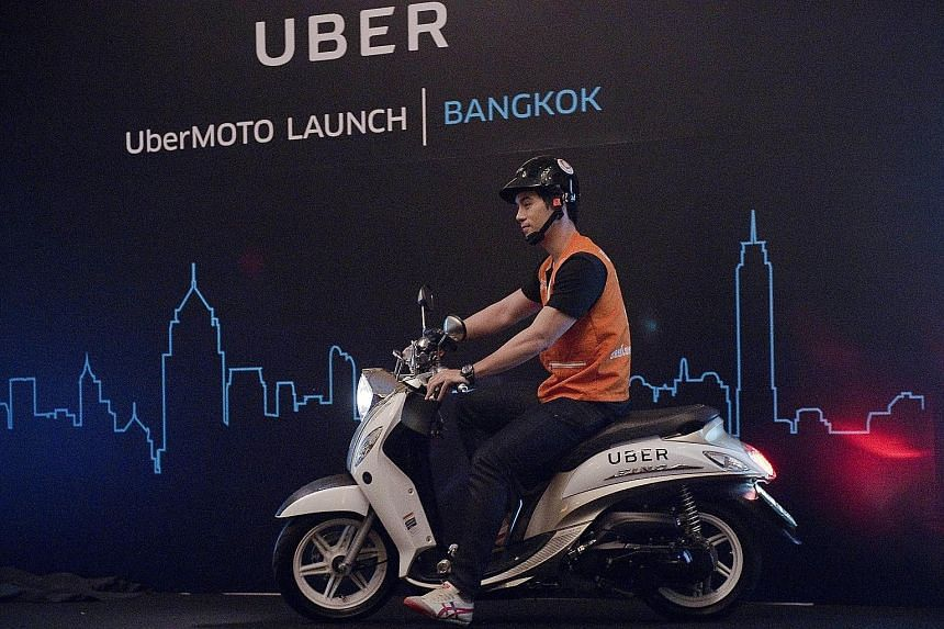 The launch of UberMOTO at a hotel in Bangkok yesterday. Uber says it will initially roll out the bikes in three commercial districts, and that the fares should be cheaper than regular motorbike taxis'.