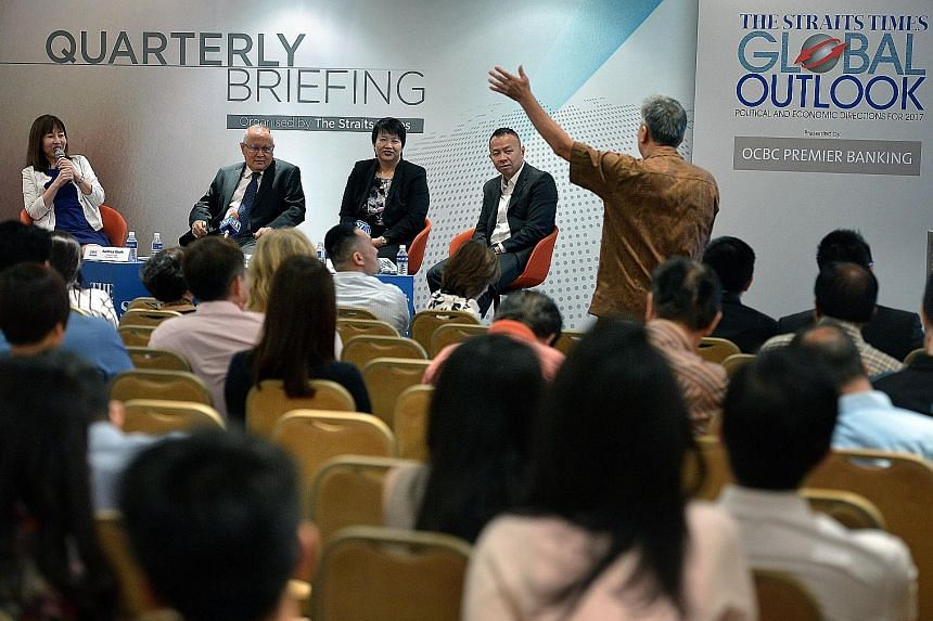 (From left) Straits Times foreign editor Audrey Quek, Mr Desker, OCBC's head of treasury research and strategy Selena Ling and Mr Chan during the question-and-answer session yesterday at the first quarterly briefing leading up to the annual Global Ou