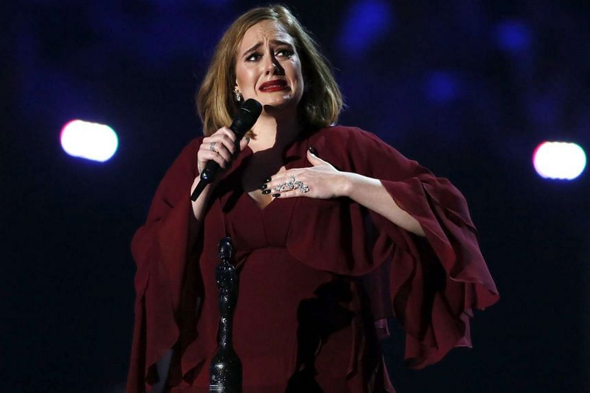 Adele reacts as she accepts the global success award at the BRIT Awards at the O2 arena in London, on Feb 24, 2016.