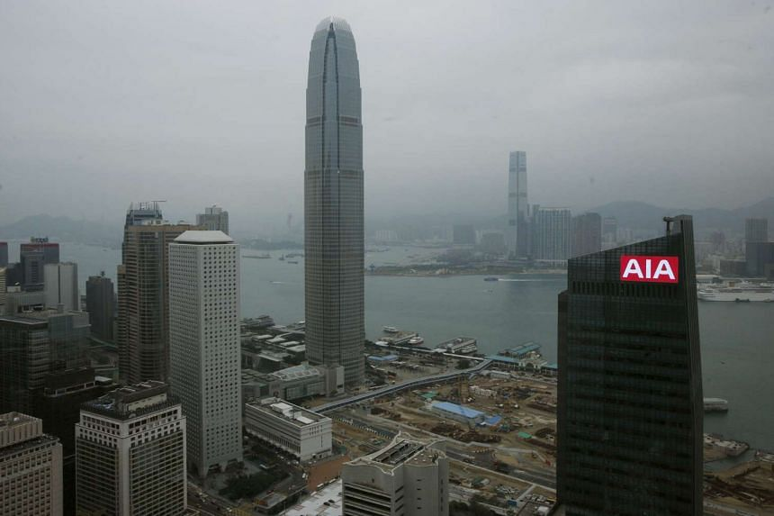 A panel on top of AIA Central flashes the company sign at Hong Kong's financial Central district in this Feb 12, 2010 file photo.