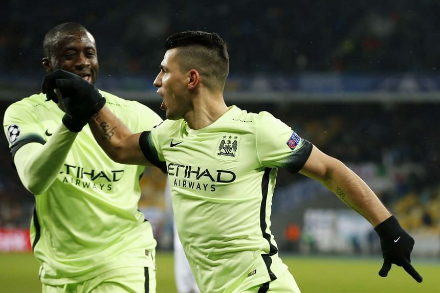 Sergio Aguero celebrates scoring the first goal for Manchester City with Yaya Toure.