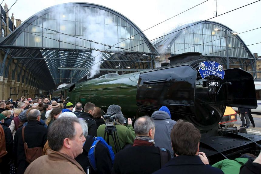 Crowds gather as the Flying Scotsman prepares to leave Kings Cross station in London, Feb 25, 2016.