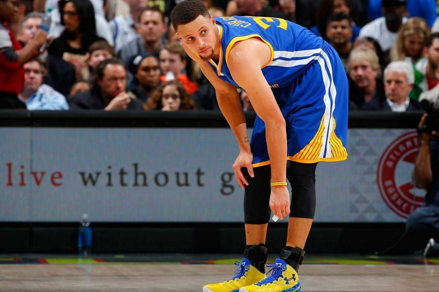 Stephen Curry of the Golden State Warriors looks on during the game on Feb 22, 2016 in Atlanta, Georgia.