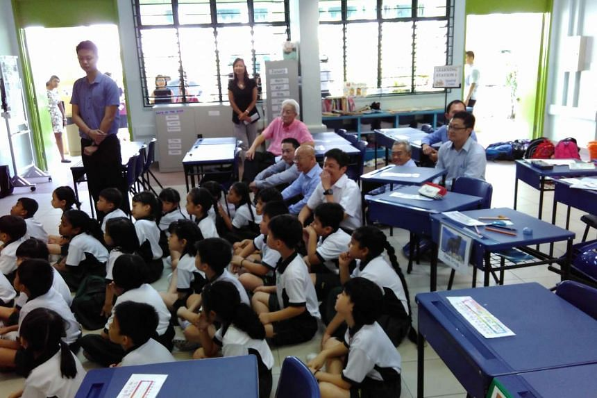 Acting Education Minister (Schools) Ng Chee Meng joining Xingnan Primary School pupils in cleaning up their classroom on Thursday (Feb 25).