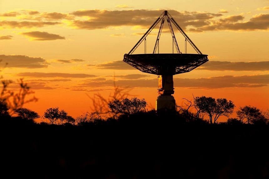 A telescope dish listens to the universe.