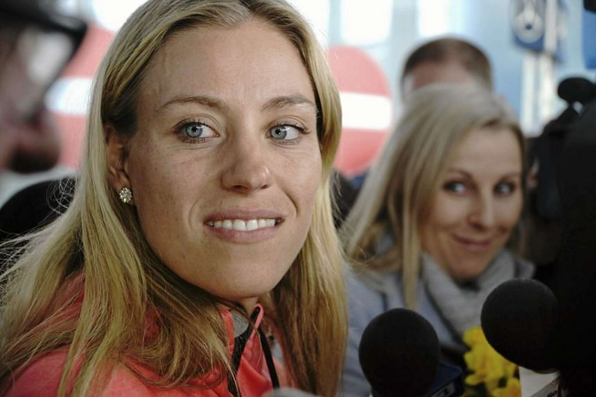 Australian Open winner Angelique Kerber speaks to the media after her arrival at the airport in Poland, on Feb 1, 2016.