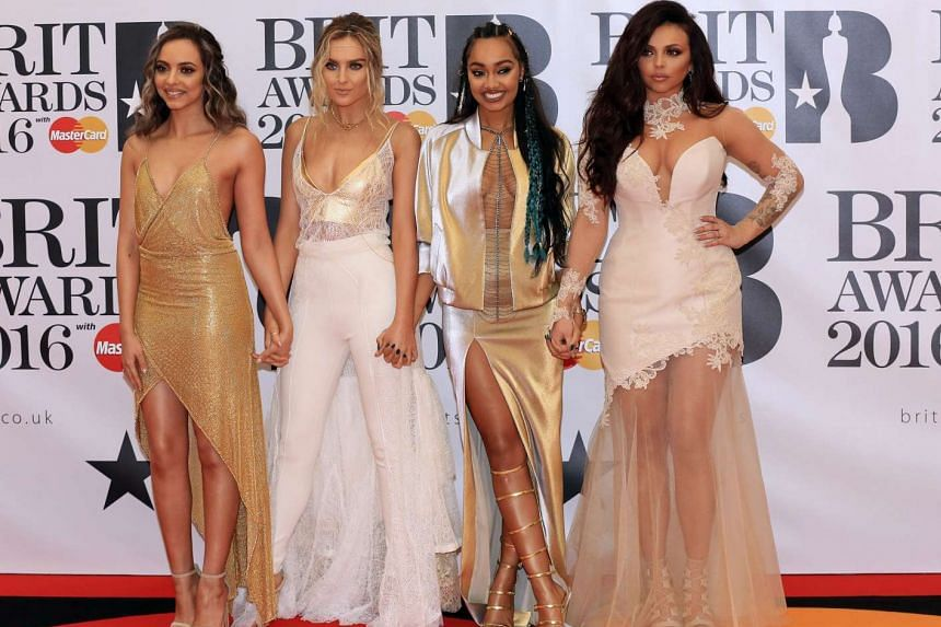 Members of British band Little Mix arrive for the Brit Awards, Feb 24, 2016.