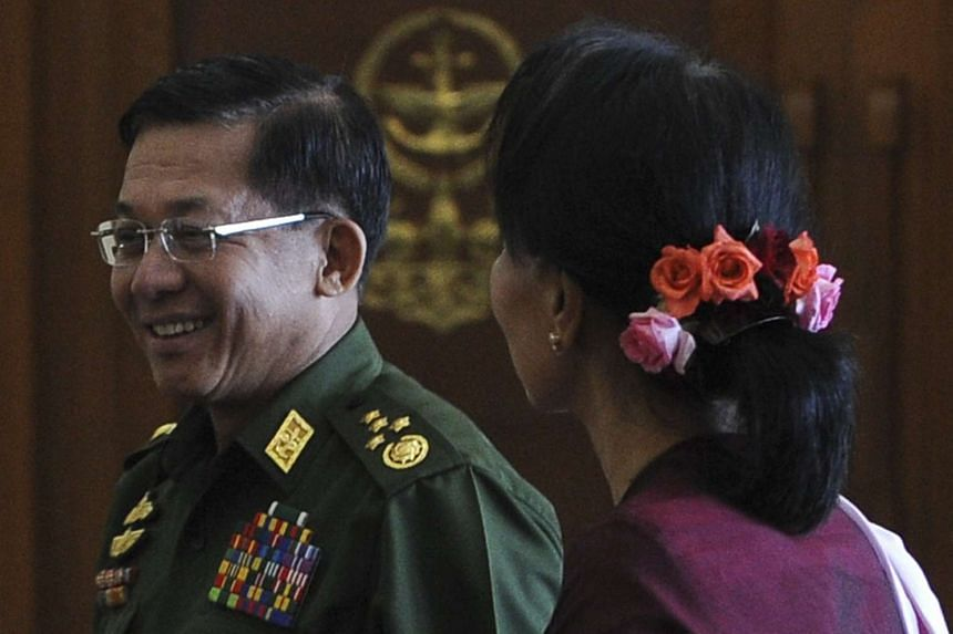Senior General Min Aung Hlaing (left) and NLD leader Aung San Suu Kyi before a meeting in Naypyidaw on Dec 2, 2015.
