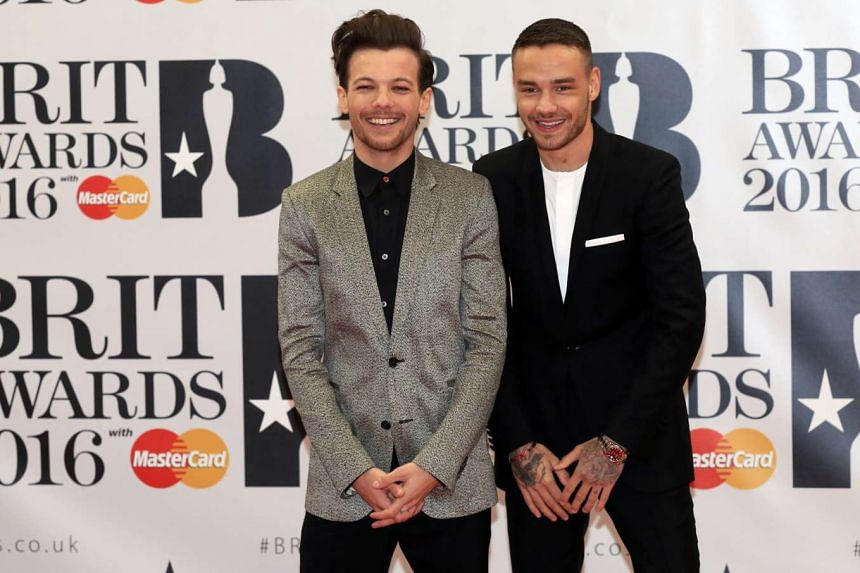 British singers Louis Tomlinson (left) and Liam Payne arrive at the Brit Awards, Feb 24, 2016.